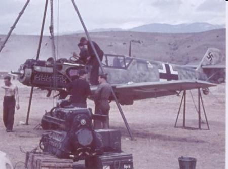 ground_crew_work_on_the_engine_of_a_bf_109e_at_the_svretv_vrax_airstrip_at_the_kresna_pass_in_bulgaria_in_1941jpg